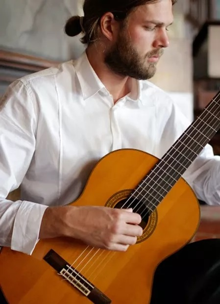 Image of Bill Dickman, a guitar teacher from Madison Wisconsin, playing classical guitar.